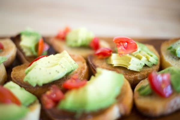 Baked pastry topped with avocado slices.